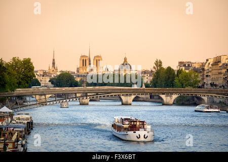 Seine River in Paris with Passerelle de Solferino bridge. In the distance, Notre Dame Cathedral and Institut de - Stock Photo