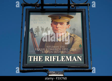 sign for the rifleman pub, twickenham, england, depicting frank edwards, the first world war 'footballer of loos' - Stock Photo