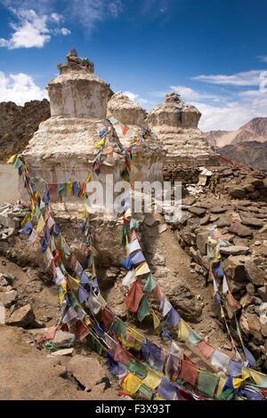 India, Jammu & Kashmir, Ladakh, Leh, line of chortens and prayer flags at entrance to Namgyal Tsemo Gompa monastery
