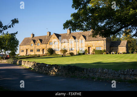 Evening sunlight on wedgewood cottages in Stanton village, Cotswolds, Gloucestershire, England - Stock Photo