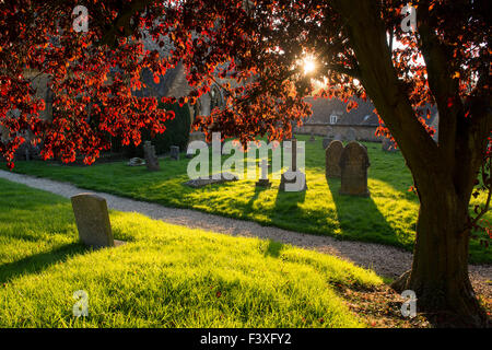 Evening sunlight on St Barnabas Churchyard, Snowshill, Cotswolds, Gloucestershire, England - Stock Photo