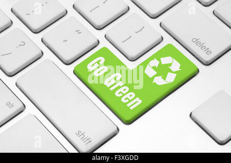 Go Green on the computer keyboard - Stock Photo