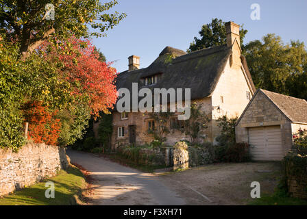 Cotswold thatched cottage in Stanton village, Cotswolds, Gloucestershire, England - Stock Photo