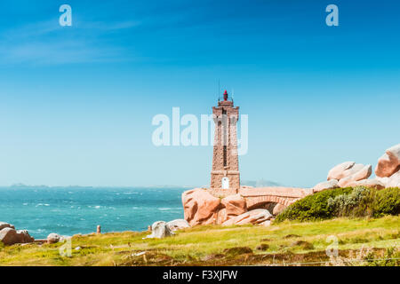 Ploumanach Mean Ruz lighthouse Brittany, France - Stock Photo