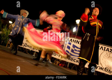 Zhivaya Rus Russian-Cossack folk dancers group performing live on stage in Myrina's port. Lemnos or Limnos island, - Stock Photo