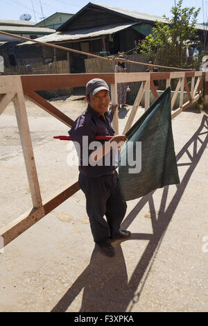 Attendant in Aungban, Myanmar, Asia - Stock Photo