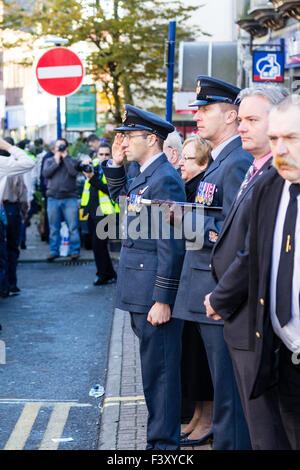 View along lines of senior officers standing saluting as a Remembrance Sunday parade marches past in the High Street - Stock Photo