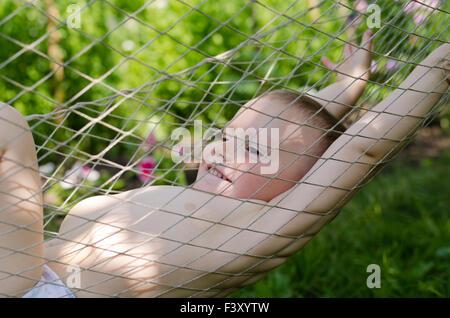 Cute little boy in a hammock - Stock Photo