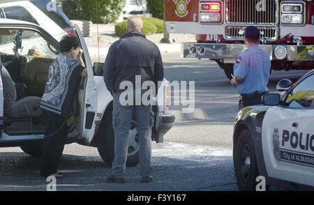 Albuquerque, NM, USA. 13th Oct, 2015. 101315.A woman is upset at scene of Jefferson and Journal Center Blvd. NE, - Stock Photo