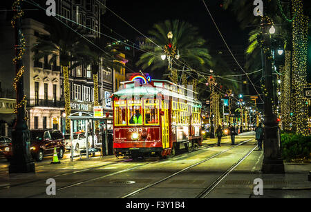 The Canal Streetcar at night among the neon lights and palm tree lighting makes for a festive ambiance in New Orleans, - Stock Photo