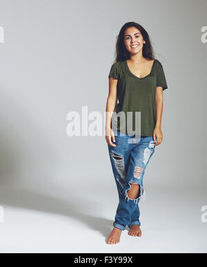 Full length portrait of a woman in jeans and a shirt. Isolated portrait
