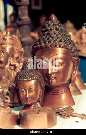 lord buddha metallic sculpture, vintage - Stock Photo