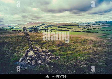 Retro Hilltop Cairn Scotland Landscape - Stock Photo