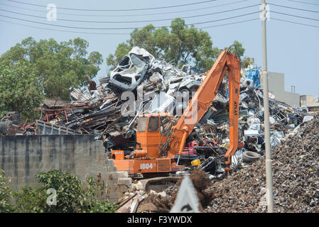 Crushed cars in scrap metal recycling yard in Malta. - Stock Photo