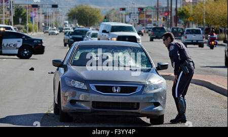 Albuquerque, NM, USA. 13th Oct, 2015. An APD motor officer investigates a vehicle vs pedestrian accident neat he - Stock Photo
