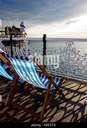 Evening on Brighton pier, East Sussex - Stock Photo