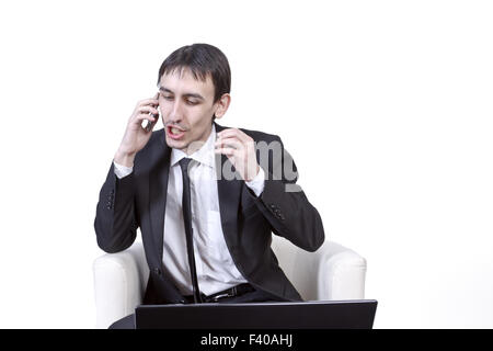 businessman talks on the phone - Stock Photo