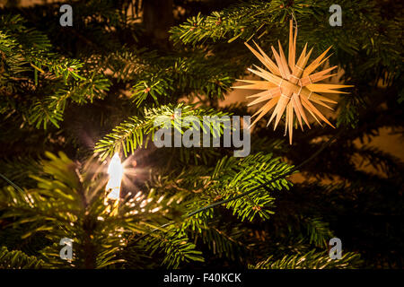Straw Star at Christmas Tree - Stock Photo