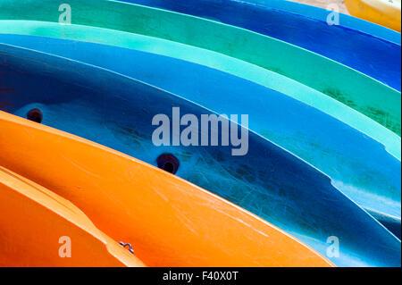 Graphic abstract view of colorful sea kayaks; Kaua'i Marriott Resort; Kalapaki Bay, Kaua'i, Hawaii, USA - Stock Photo