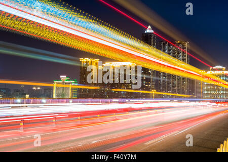 fiery light trails at night - Stock Photo