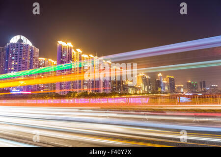 busy city traffic at night - Stock Photo