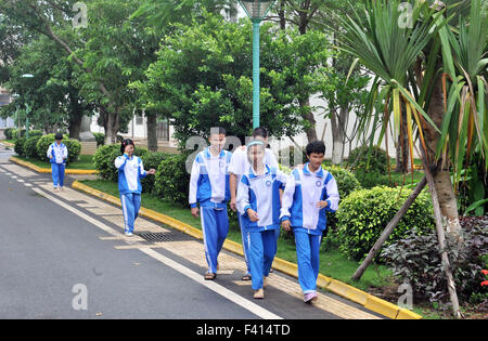 Haikou, China's Hainan Province. 13th Oct, 2015. Visually-impaired children walk in campus at Hainan (Haikou) Special - Stock Photo