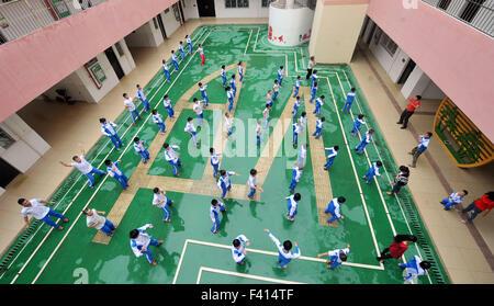 Haikou, China's Hainan Province. 13th Oct, 2015. Children do exercises in Hainan (Haikou) Special School in Haikou, - Stock Photo