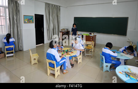 Haikou, China's Hainan Province. 13th Oct, 2015. Children have a handcraft lesson at Hainan (Haikou) Special School - Stock Photo