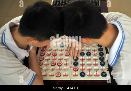 Haikou, China's Hainan Province. 13th Oct, 2015. Children play Chinese chess at Hainan (Haikou) Special School in - Stock Photo