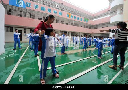 Haikou, China's Hainan Province. 13th Oct, 2015. Students do exercises with teachers at Hainan (Haikou) Special - Stock Photo