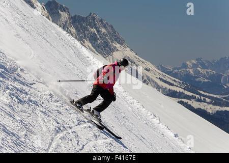 Teenage girl, downhill skier, going down steep Alpine slope. Concept of enjoying winter activities. - Stock Photo