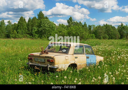 The old car in the village. - Stock Photo