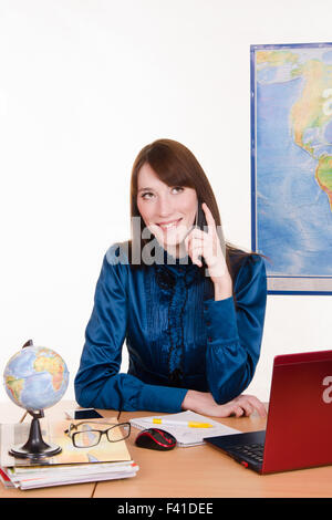 travel agency manager talking on the phone stock photo - Agency Manager