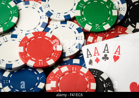four of a kind poker hand Aces and chips - Stock Photo