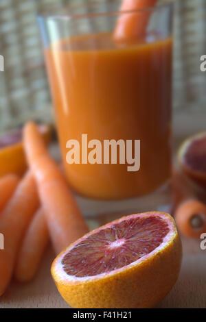 Halved Orange and Carrot-Orange Juice - Stock Photo
