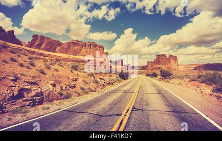 Vintage retro stylized scenic desert road, USA. - Stock Photo