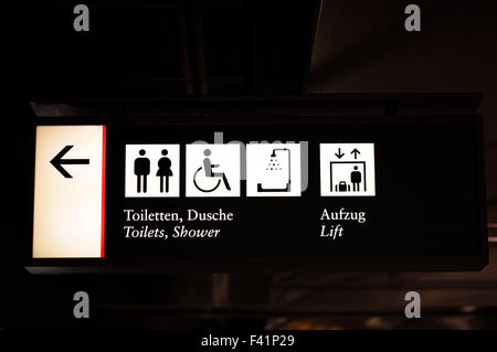 Guide plate to the toilets and the lift - Stock Photo