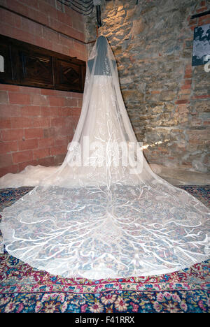 Wedding dress embroidered on tulle by Paola Matteucci with the technique of the Ars Panicalensis, Panicale, Umbria, - Stock Photo