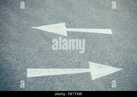 Arrows on a road - Stock Photo