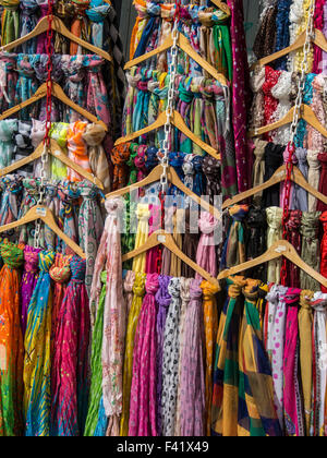 Brightly coloured scarves for sale in Market - Stock Photo