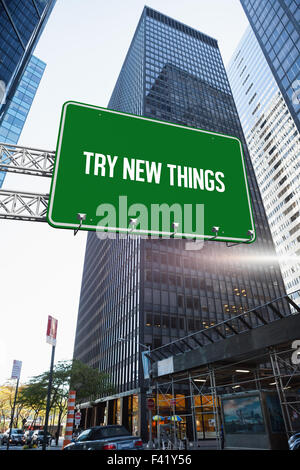 Try new things against skyscraper in city - Stock Photo