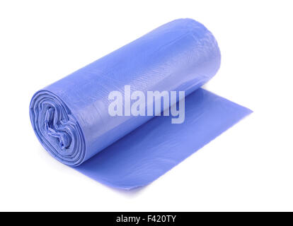 Roll of blue plastic garbage bags isolated on white - Stock Photo