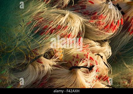 mending the nets, Mũi Né fishing village, Bình Thuận Province, Vietnam - Stock Photo