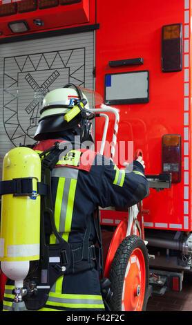 Firefighter on emergency vehicle respirator - Stock Photo