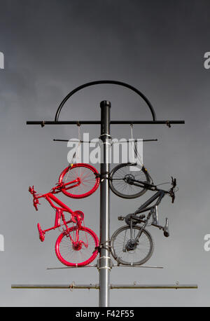 Two bikes, red & black used as Street Furniture, art, sculpture, bike, architecture, city, bicycle travel in Colne - Stock Photo