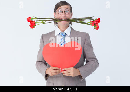 Geeky businessman offering valentines gifts - Stock Photo