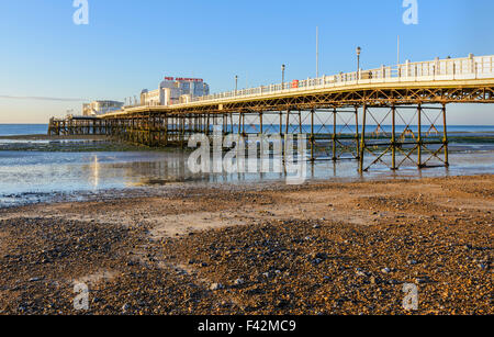 Worthing Pier at low tide in Worthing, West Sussex, England, UK. - Stock Photo