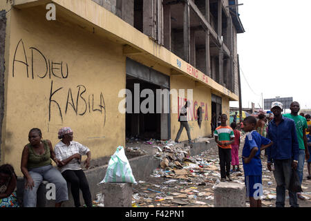 Graffiti saying Goodbye Kabila on the wall of a store that was looted during violent riots against President Kabila - Stock Photo