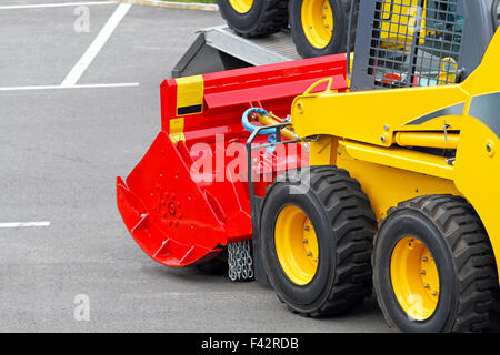 Skid steer attachment - Stock Photo