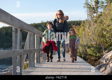 Mother and three children enjoying nature walk - Stock Photo